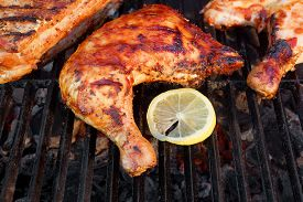 image of braai  - BBQ Roasted Chicken Leg Quarter On The Hot Charcoal Grill Close - JPG