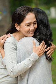 pic of  friends forever  - Mature woman tightly hugging her best friend - JPG