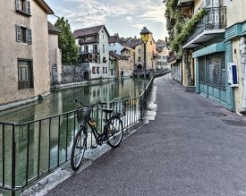 foto of annecy  - Street in Annecy old city with colorful houses and a bike - JPG